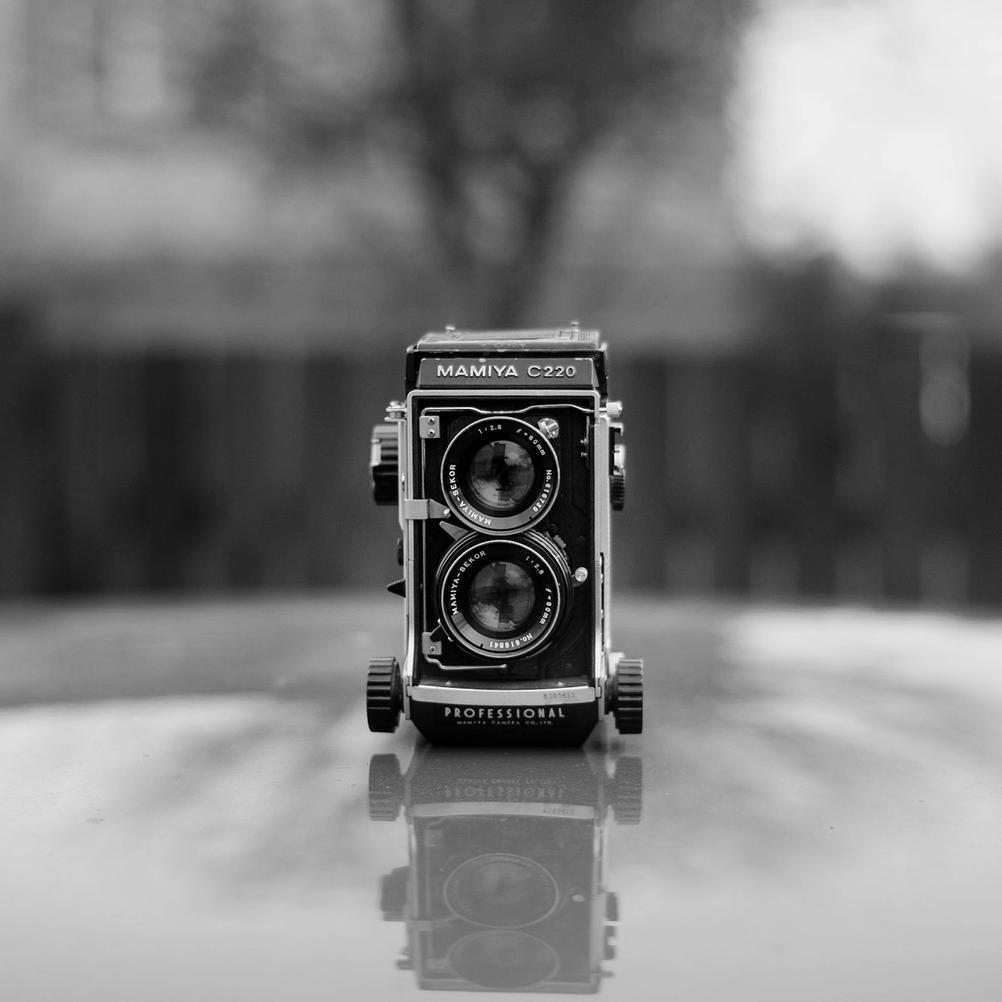 Black and white photo of Mamiya C220 with Mamiya-Sekor 80mm f2.8 lens.