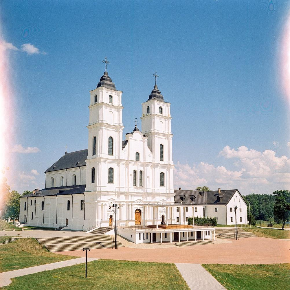 Photo of a big and white church.