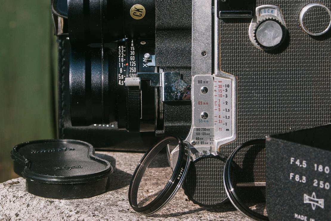 Closeup of Mamiya Super-Sekor 180mm f4.5 lens together with accessories.