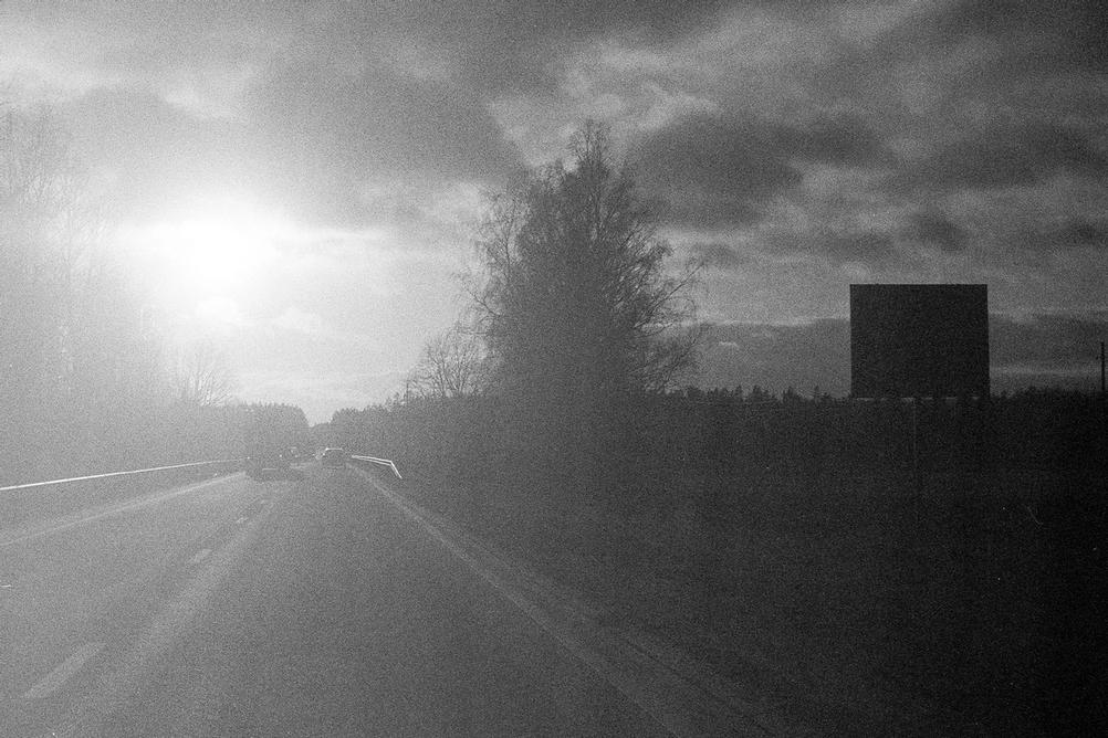 Photo with road against bright sunlight.