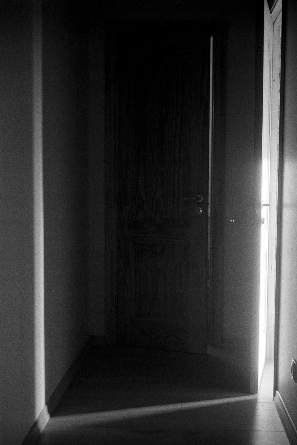 Photo light shining through a thin opening through the door.