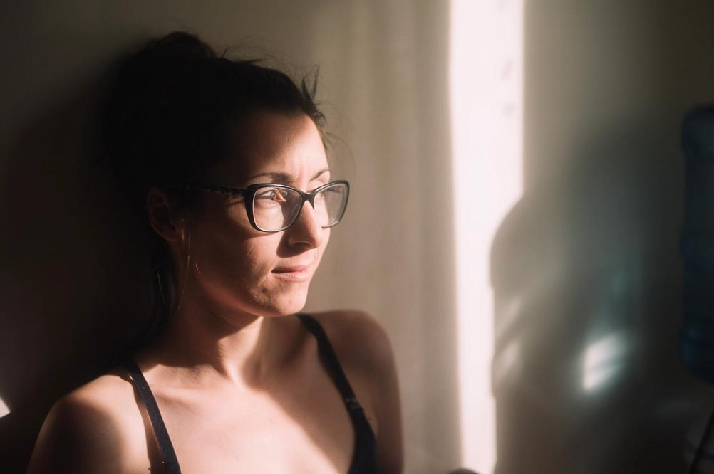 Photo of a woman in strong sunlight.