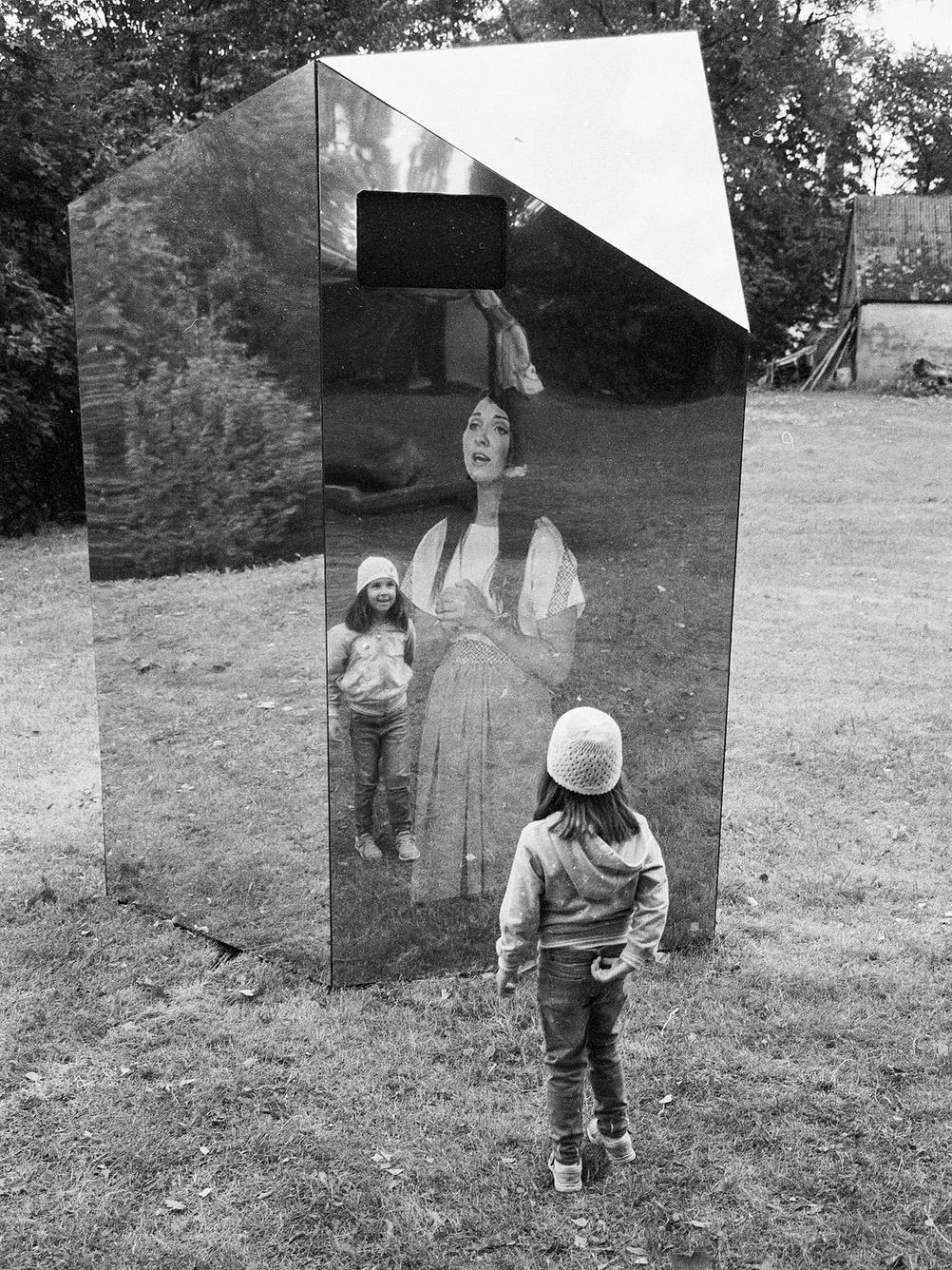 Photo of my daughter next to an art installation.