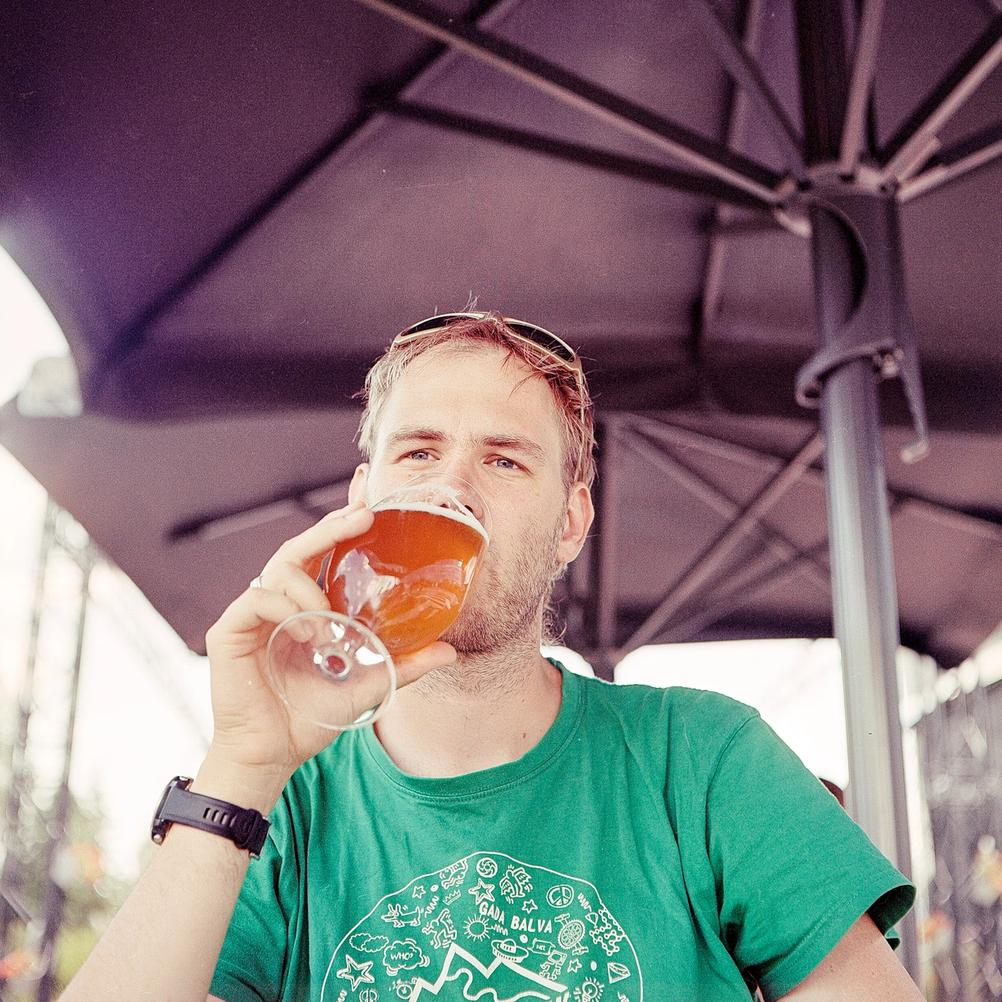 Photo of a man drinking beer.