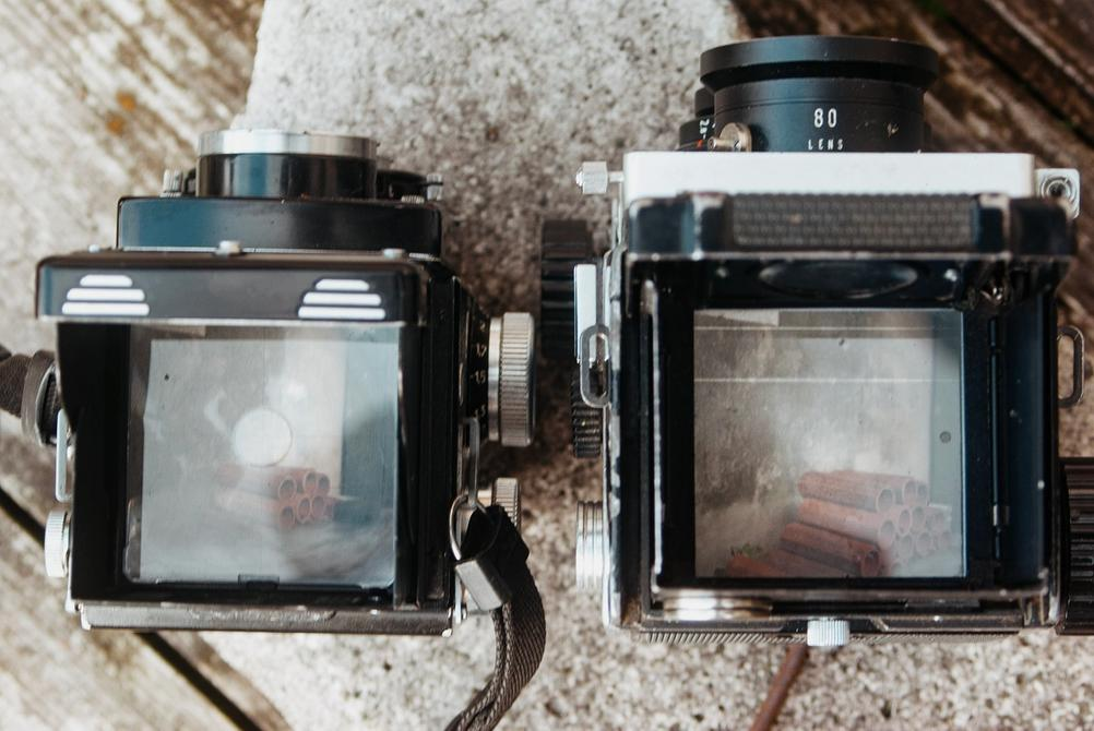 Photo of Rolleicord V and Mamiya C220 viewfinders.
