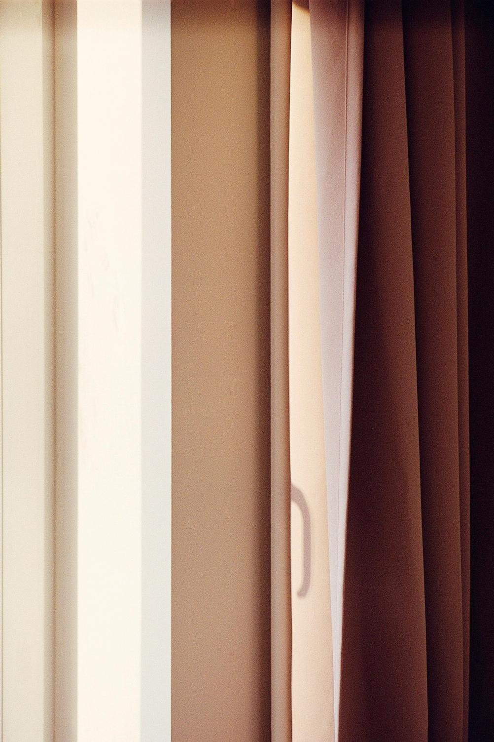Abstract photo of window and curtains.