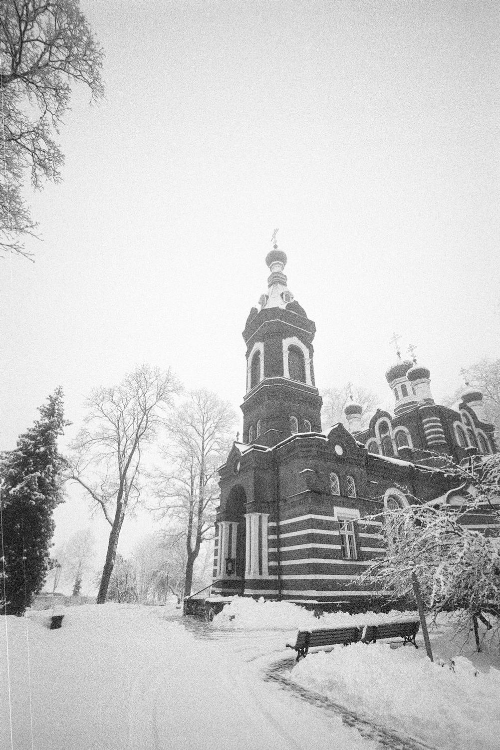 Photo of a church in wintery mist.