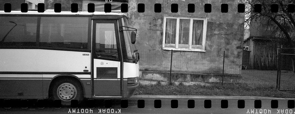 Bus next to a house - scanned with sprockets.