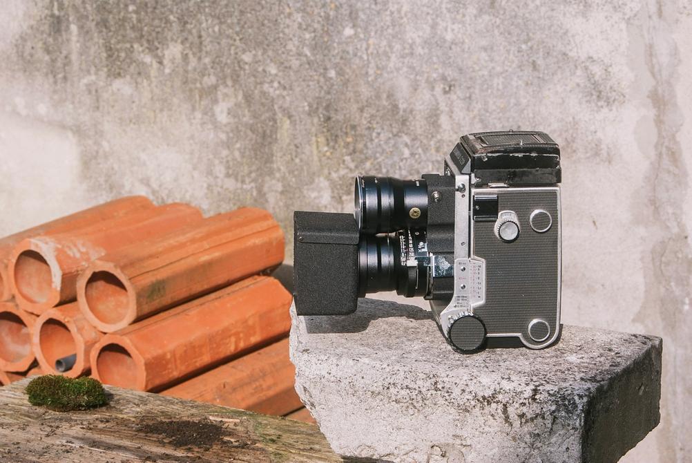 Photo of Mamiya C220 with Mamiya Super-Sekor 180mm f4.5 and accessories.