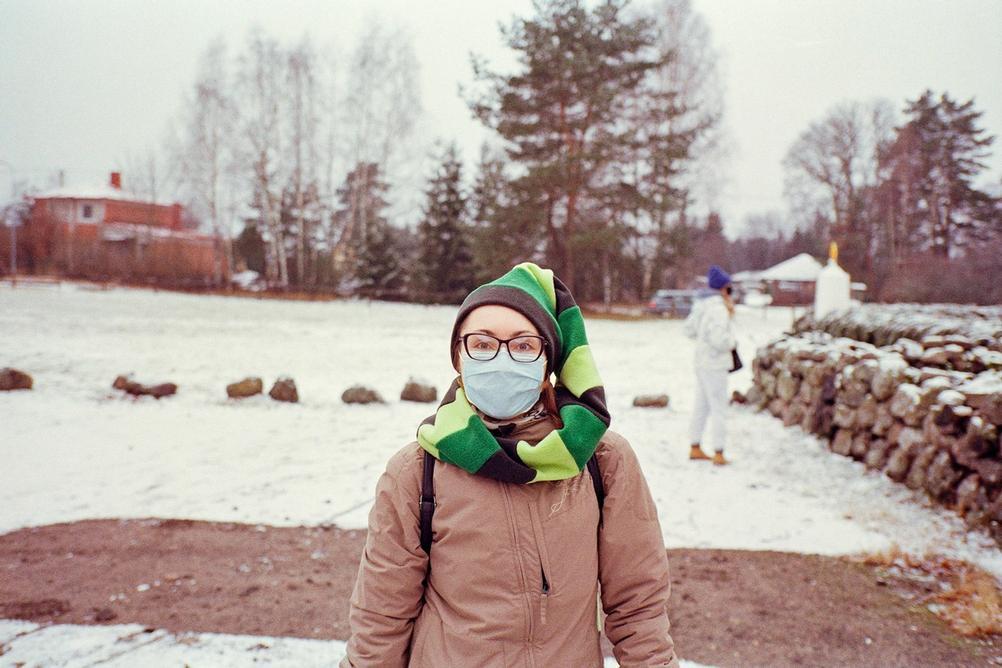 Photo of a woman wearing a mask.