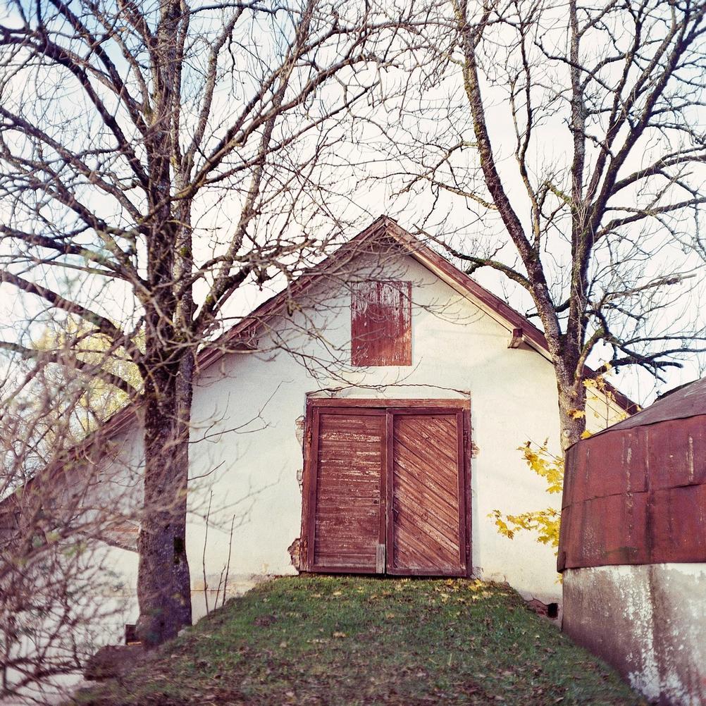 Photo of a red barn door.