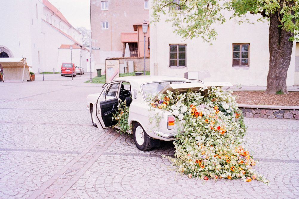 Photo of flowers exploding out of a car.