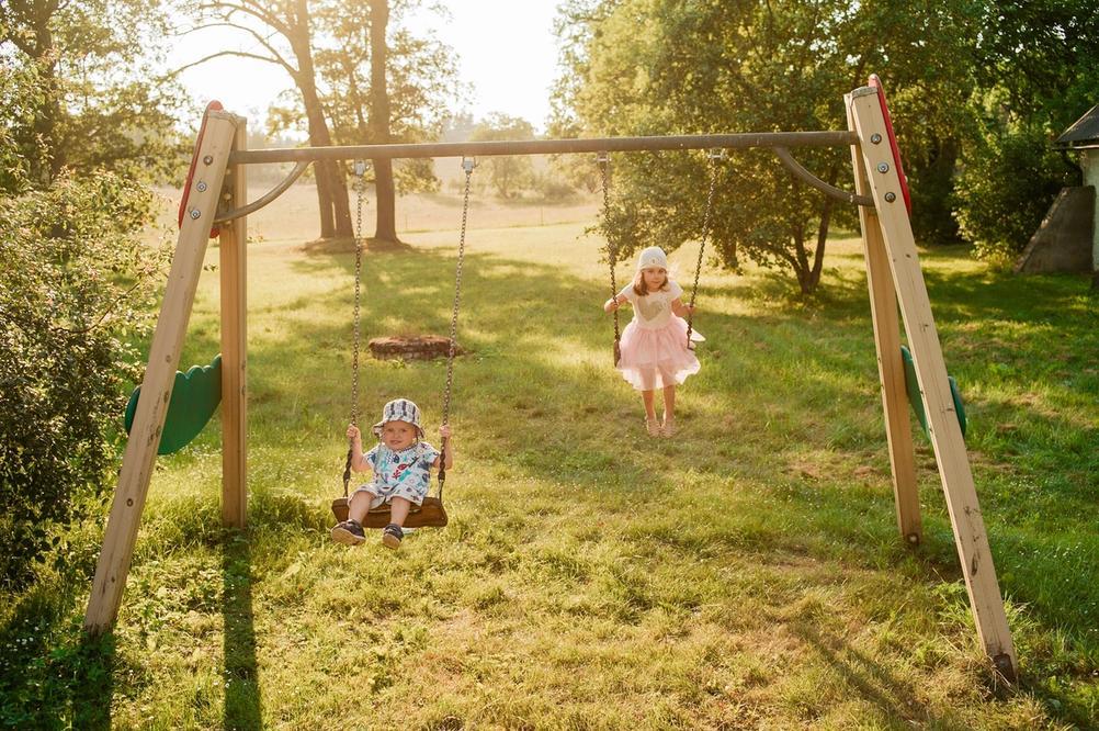 Photo of my children on swings.