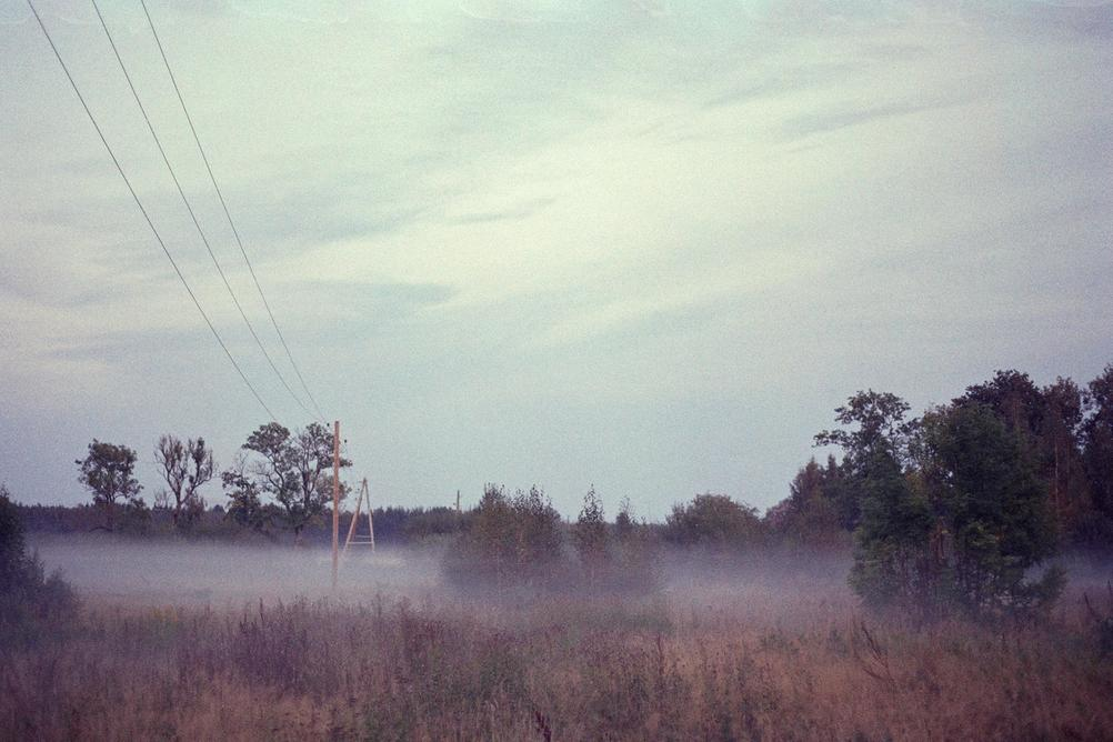 Photo of a field with light mist that looks quite boring.