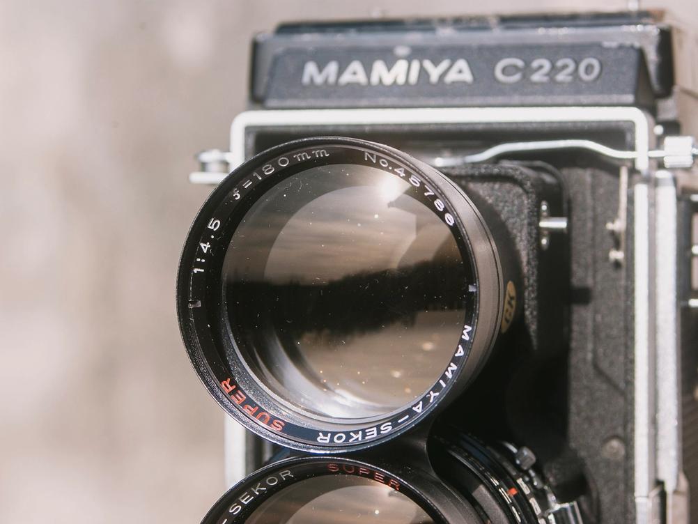Closeup photo of the Mamiya Super-Seko 180mm f4.5 viewing lens.