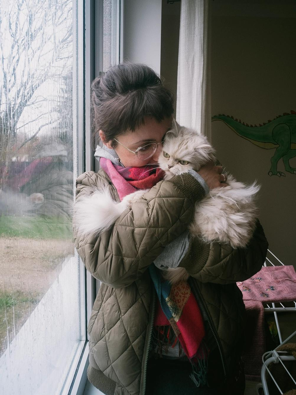 Photo of my wife holding my grumpy cat.