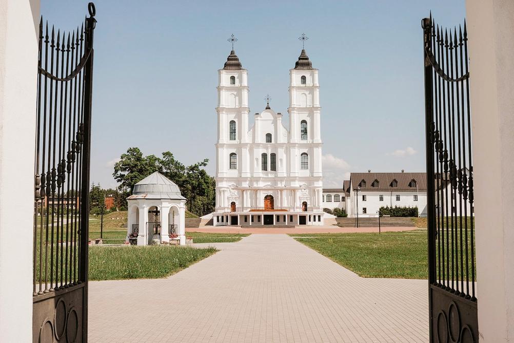 Photo of a church through open gate.