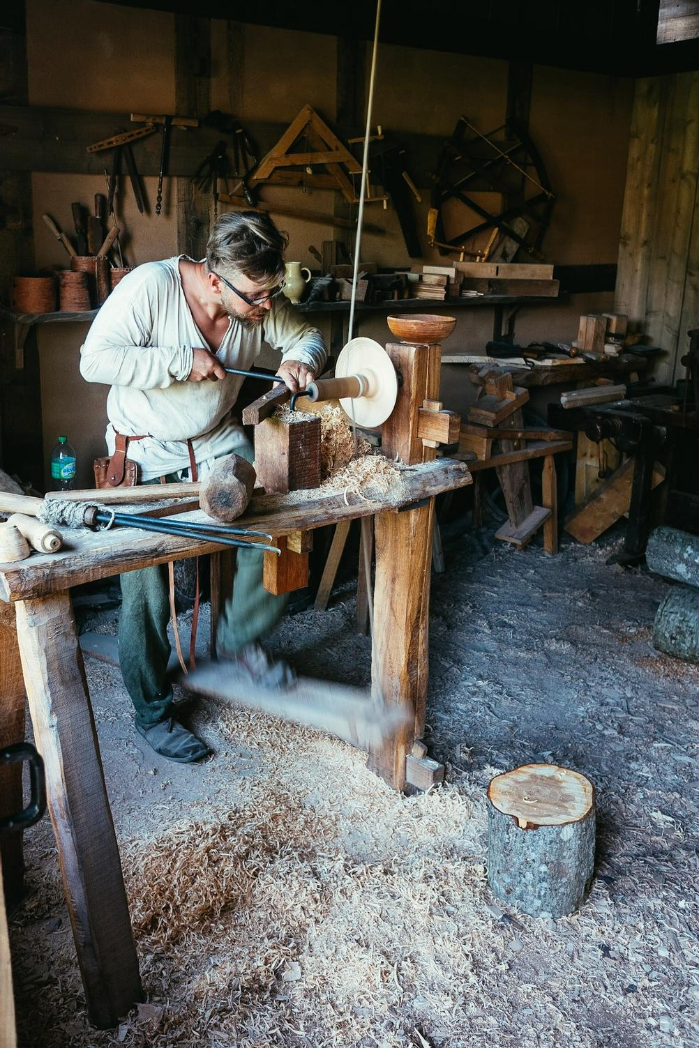 Photo of a man working dressed in historic clothes.