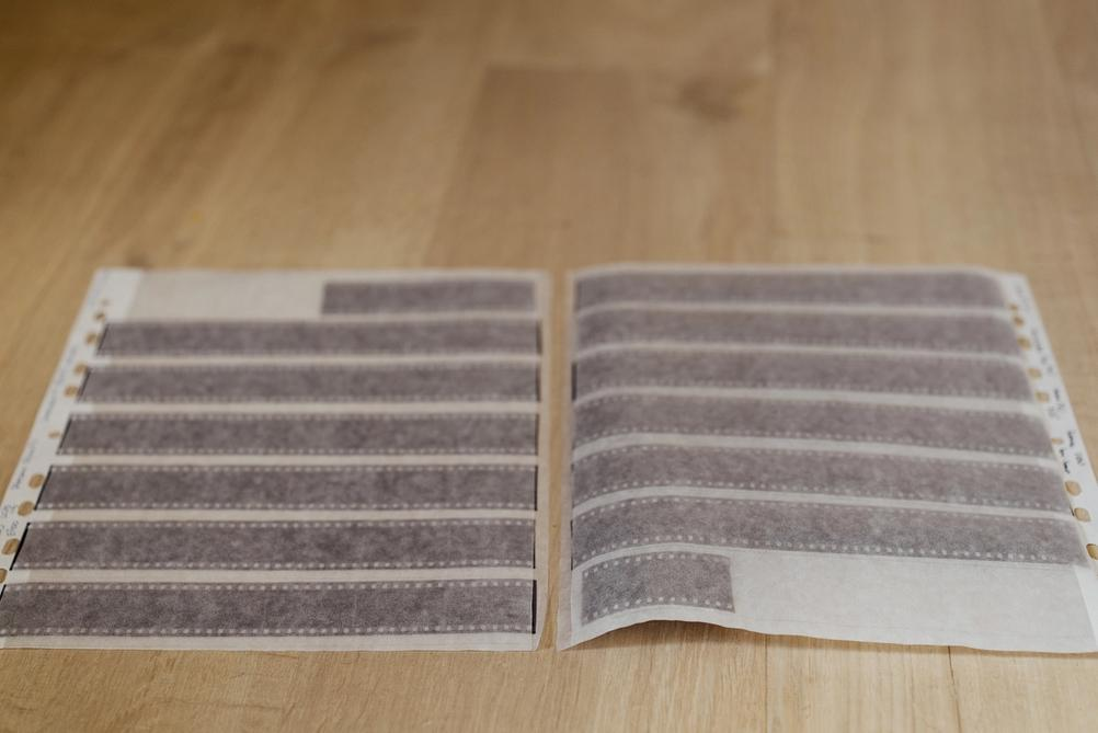 Two 35mm film archive sleeves containing film.