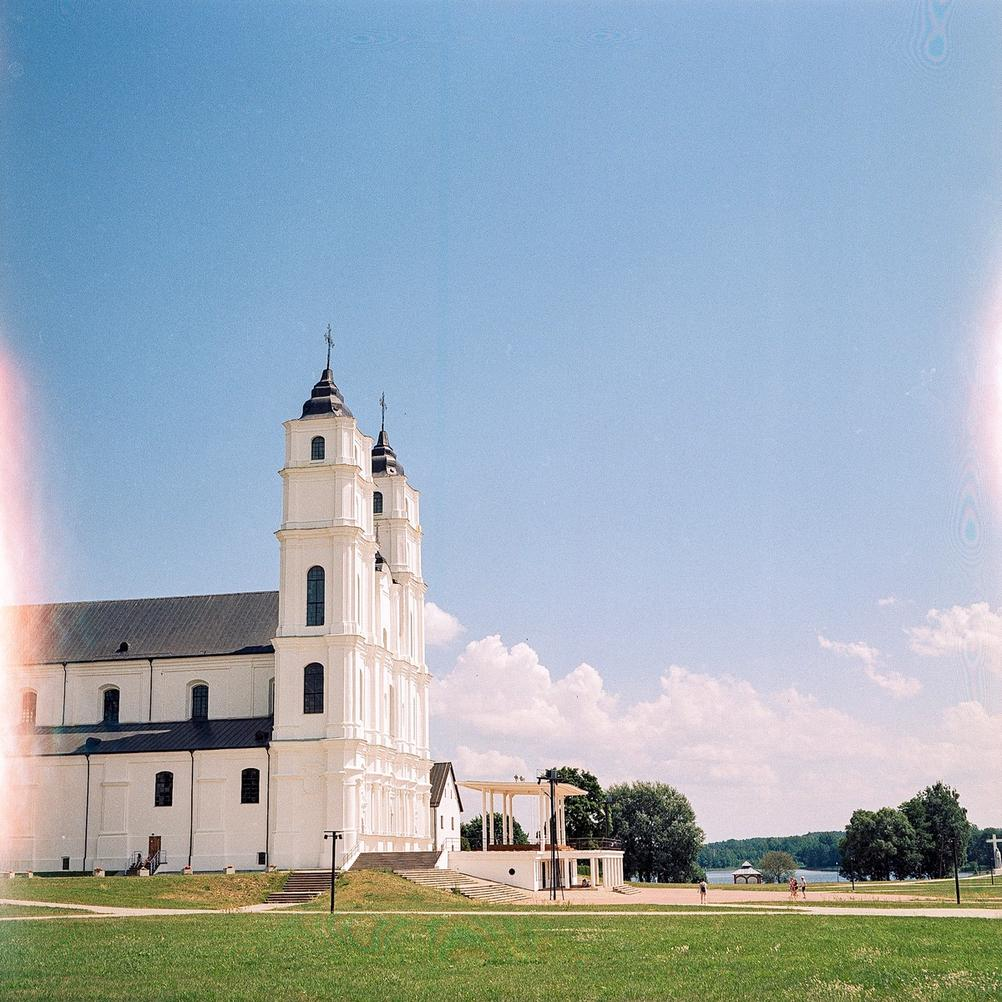 Photo of a large and white church