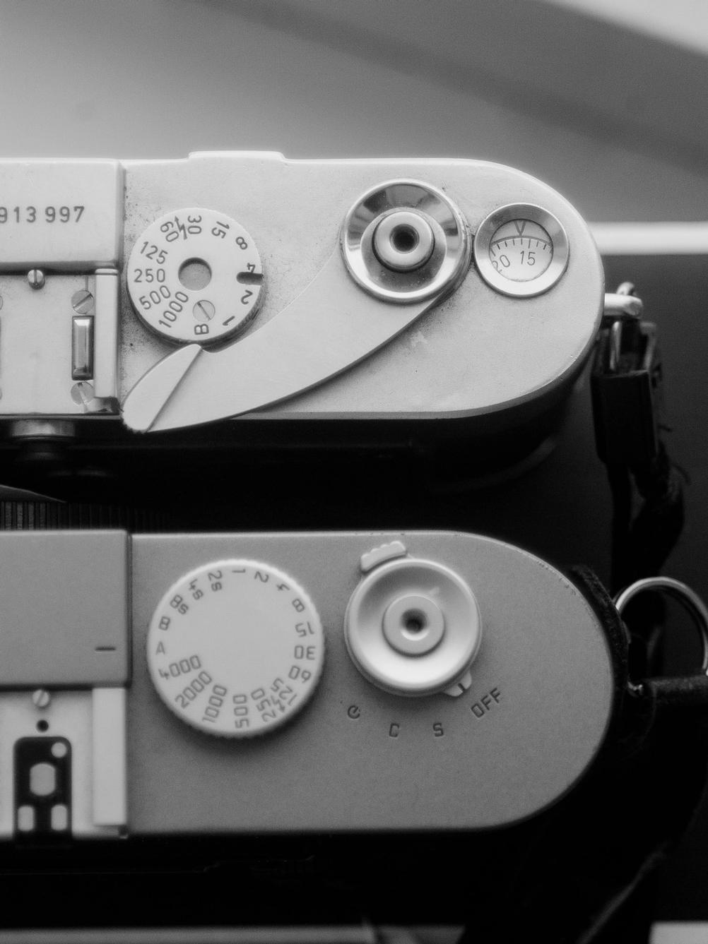 Closeup photo of Leica M3 and M9 top plates.
