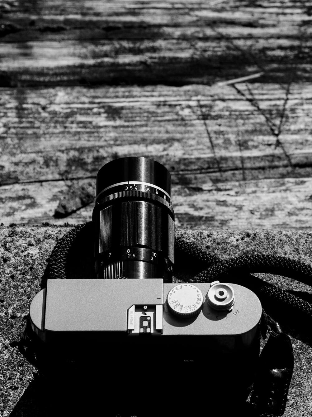 Photo of Leica M9 with a Canon 135mm f3.5 LTM lens on it.