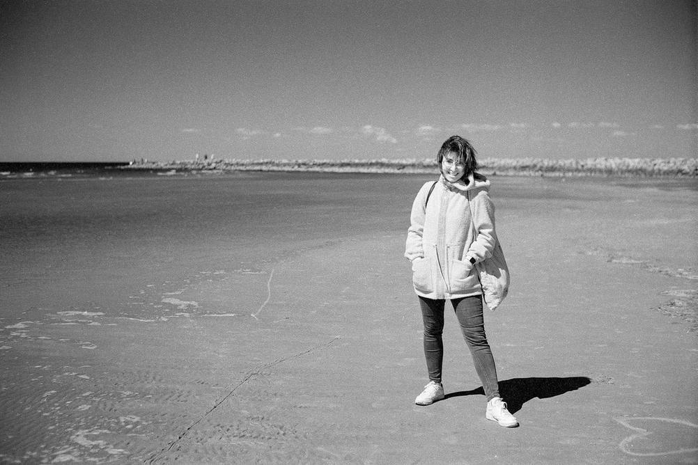Photo of my wife on a beach.