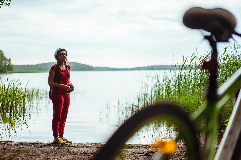 Photo of a girl next to a lake.