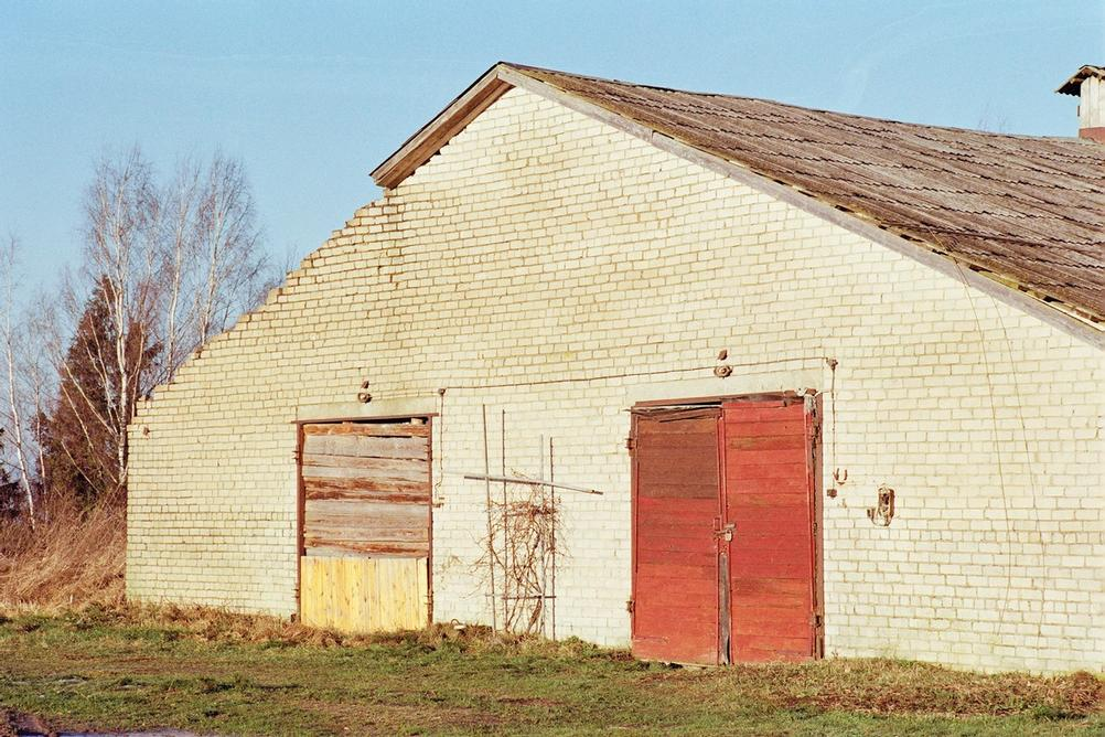 Photo of a barn with two doors.