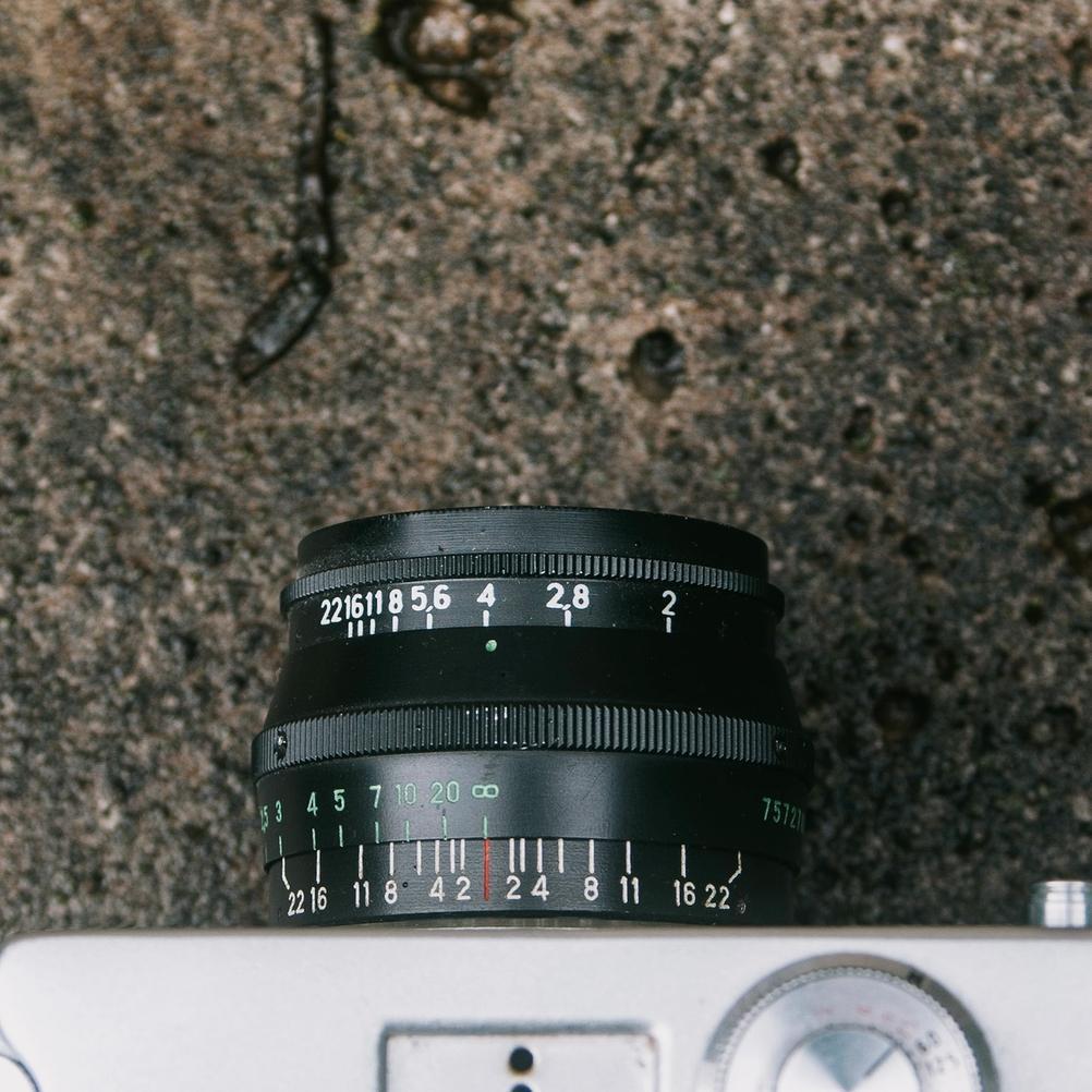 Closeup photo of a black Jupiter-8 50mm f2 lens.