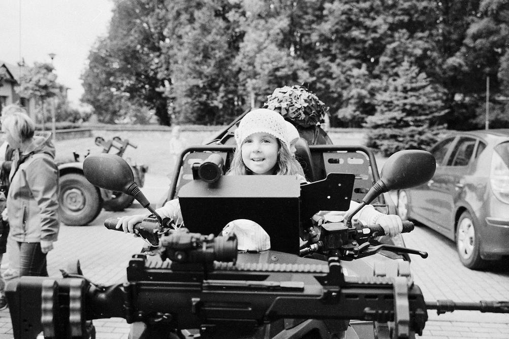 Photo of my daughter on a military vehicle.