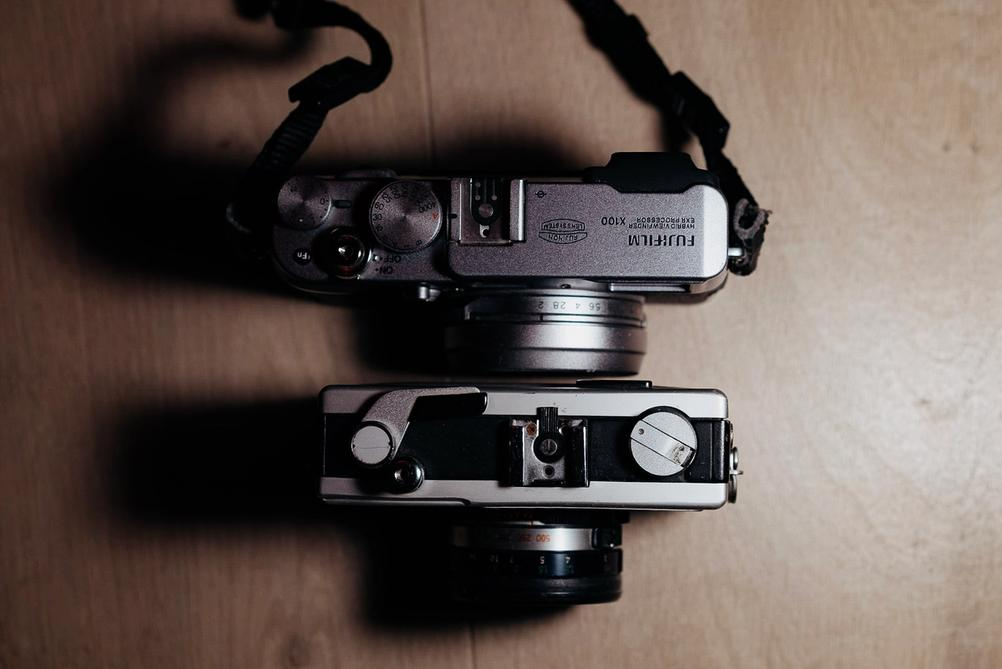 Photo of Ricoh 500G and Fujifilm X100.
