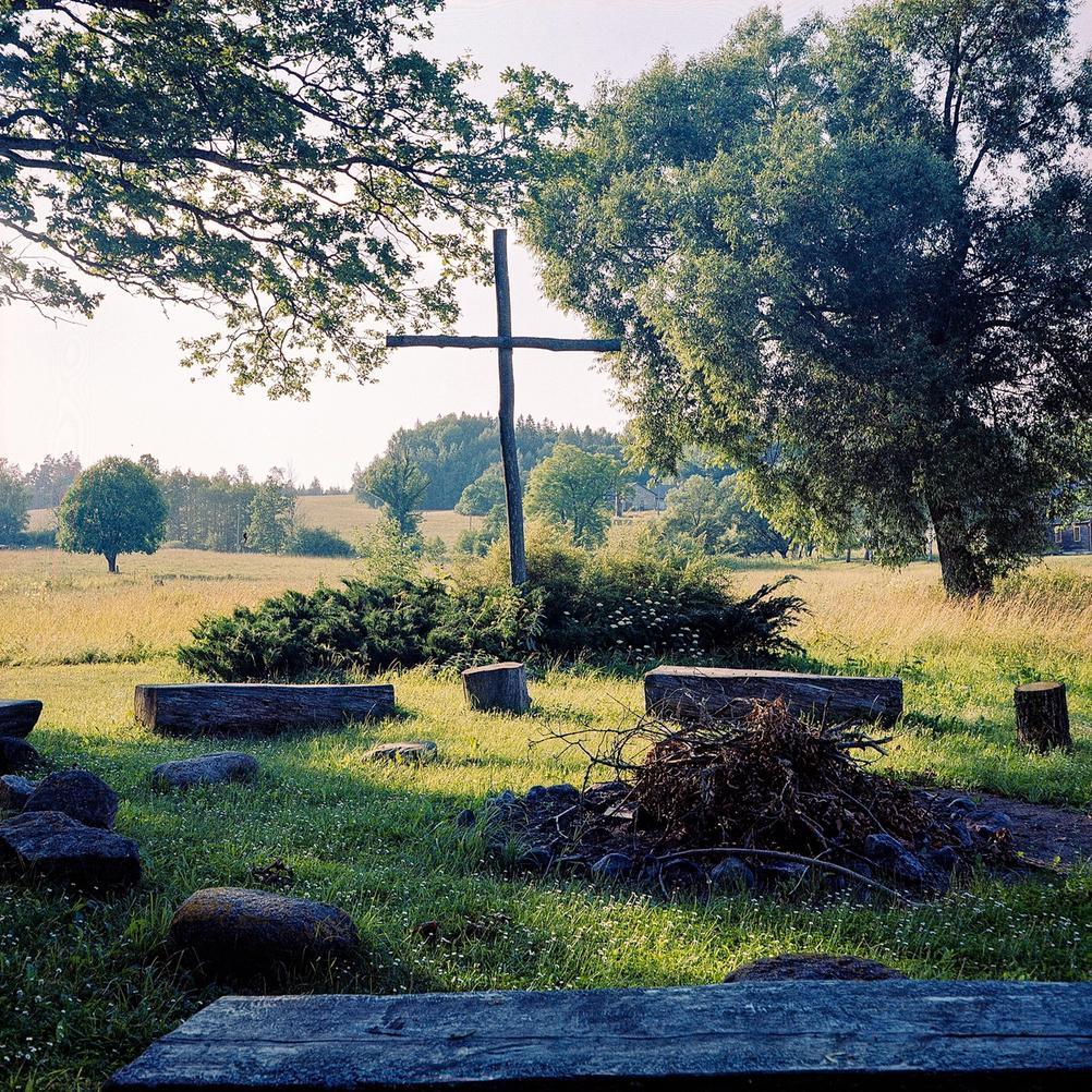 Photo of a cross in a field.