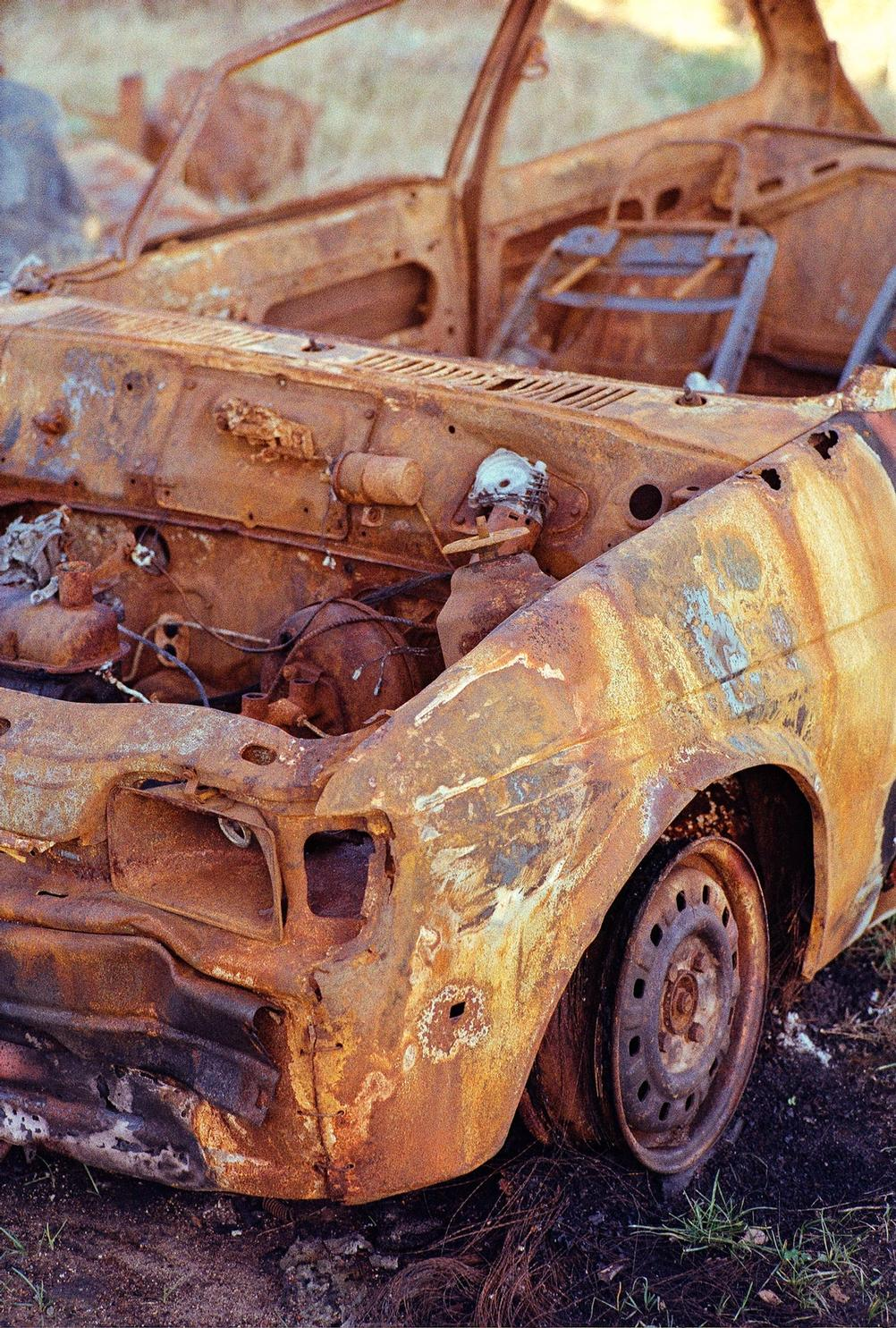Closeup of a rusted car.