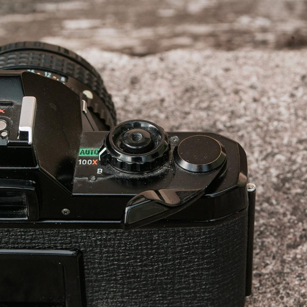 Photo of Pentax MV1 film advance lever in the second position.
