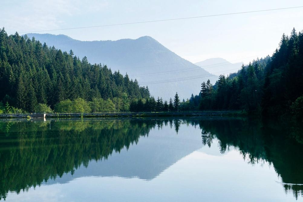 Photo of mountains and their reflection in the lake.