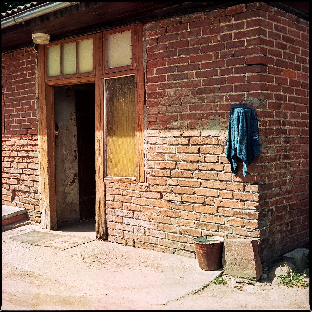 Photo of a door on a brick house.
