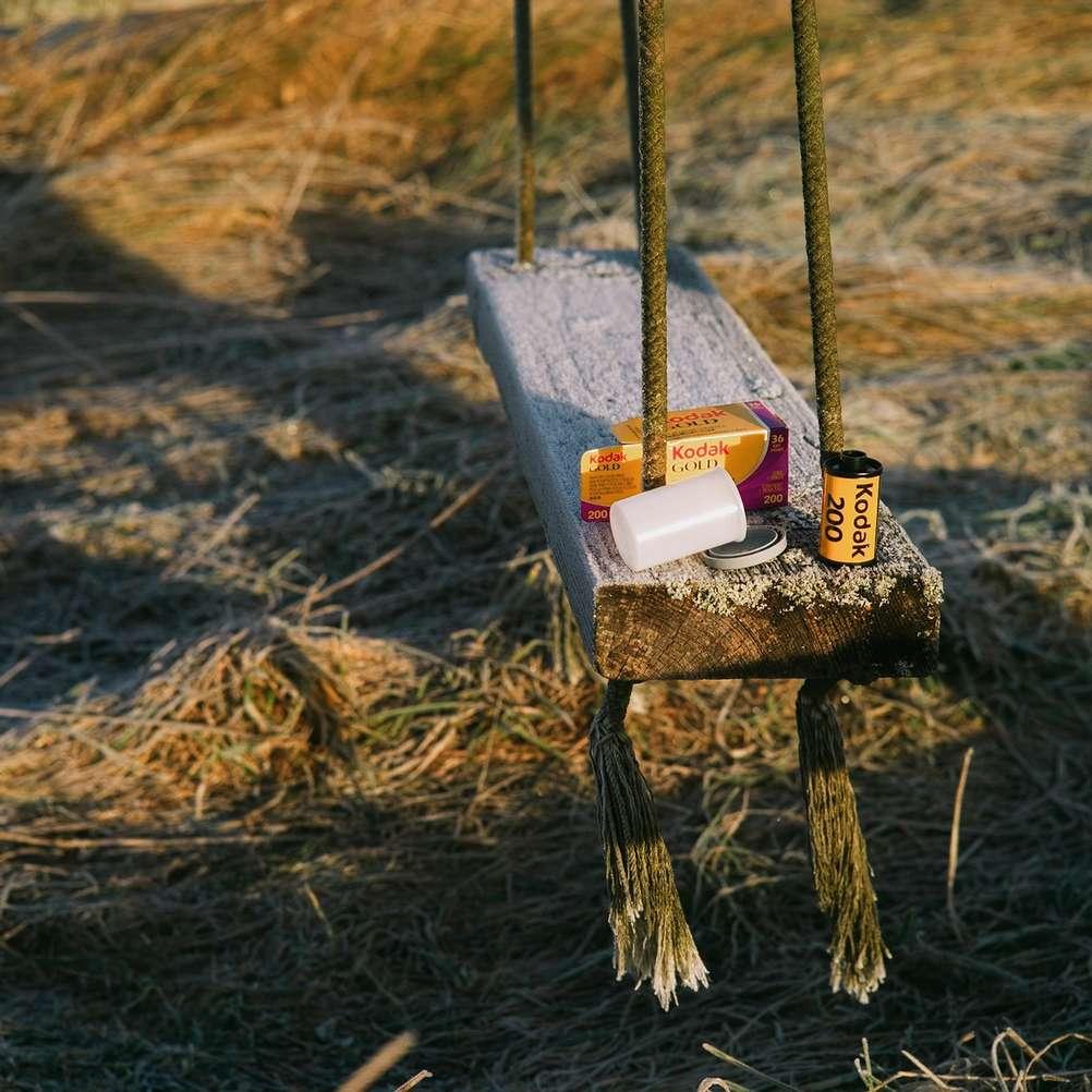 Kodak Gold 200 film on swings in the sun.