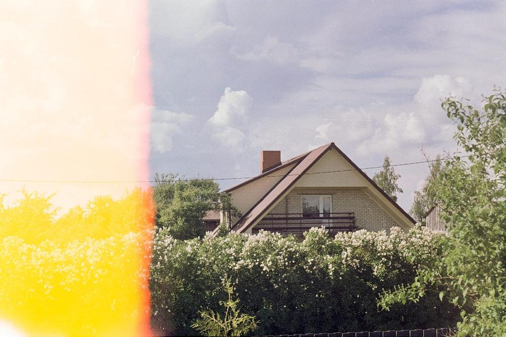 Photo of a house with a light leak coming from the left side.