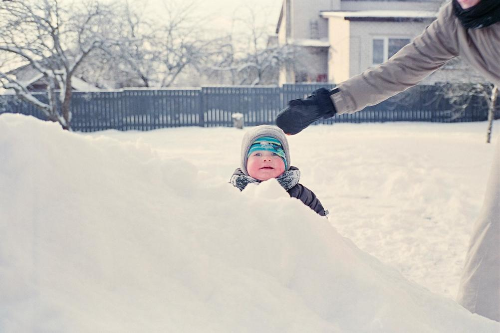 Picture of a one year old in snow.