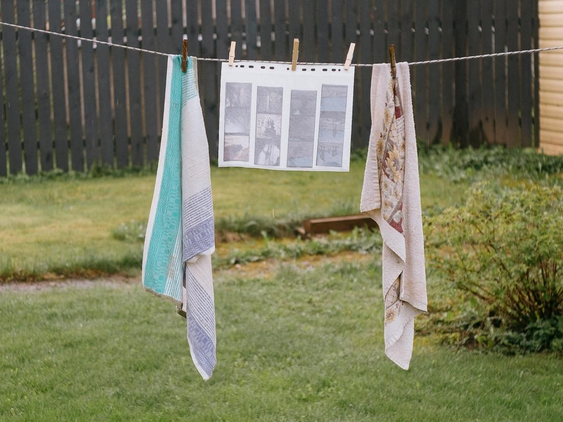 Photo of film hanging together with dirty kitchen towels.