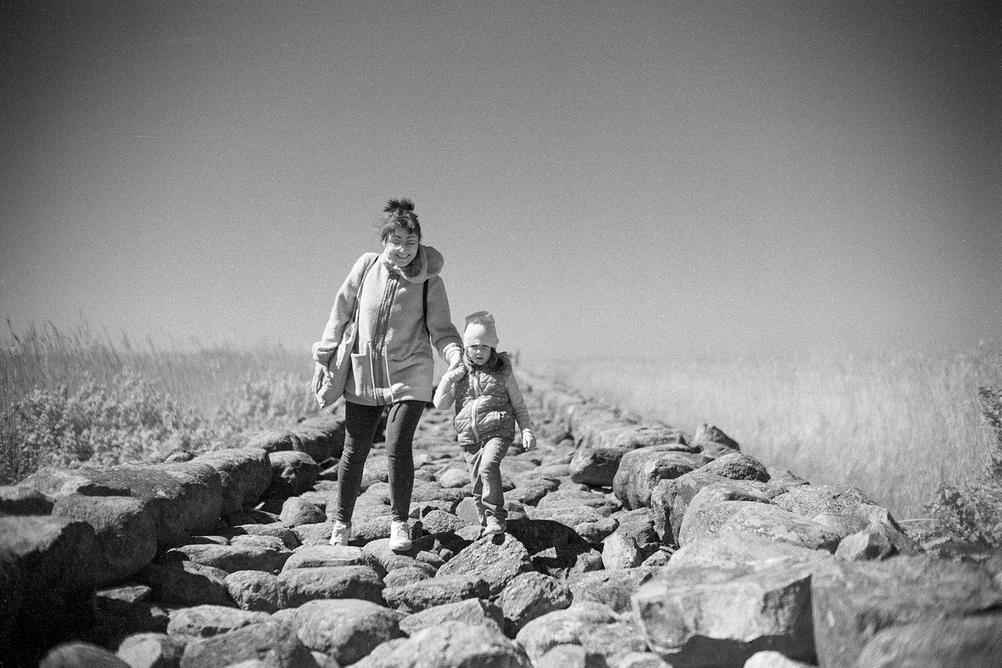 Photo of my wife and daughter walking on a very rocky road.