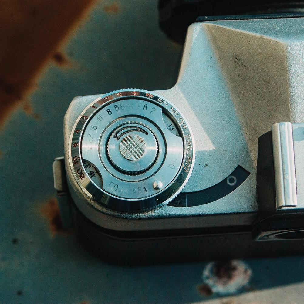 Photo of Zenit-E light meter controls and film rewind knob.