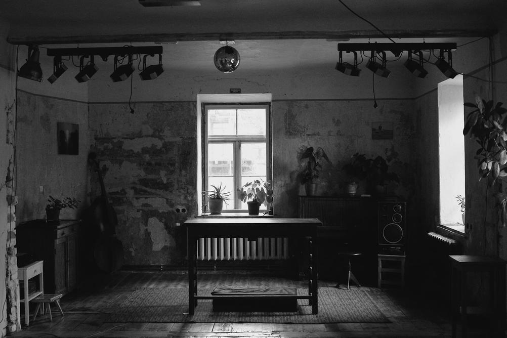 Black and white photo of indoor room.