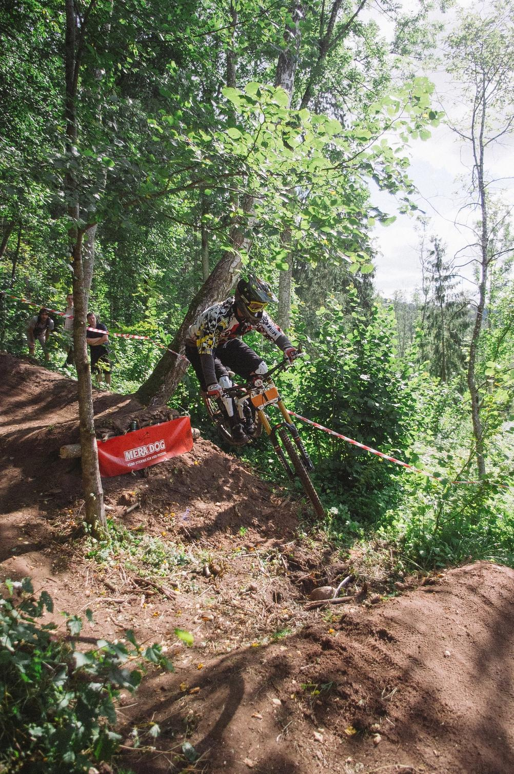 Downhill racer jumping over a gap during race