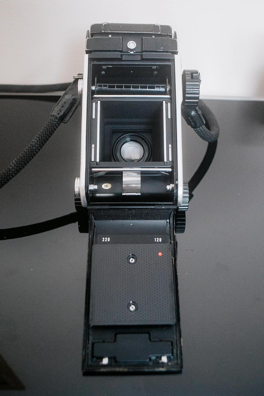 Mamiya C220 camera back open.