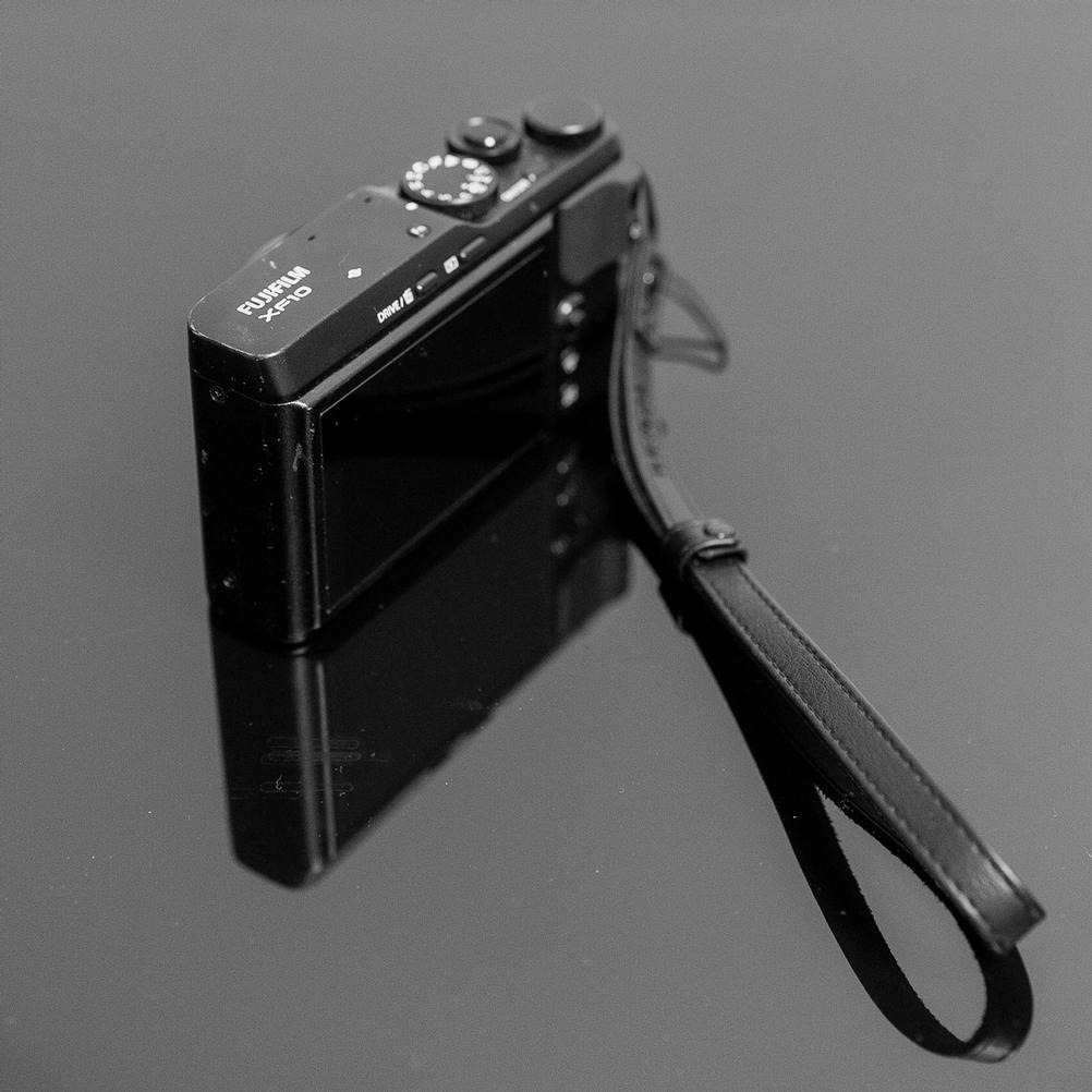 A photo of a well used Fujifilm XF10.