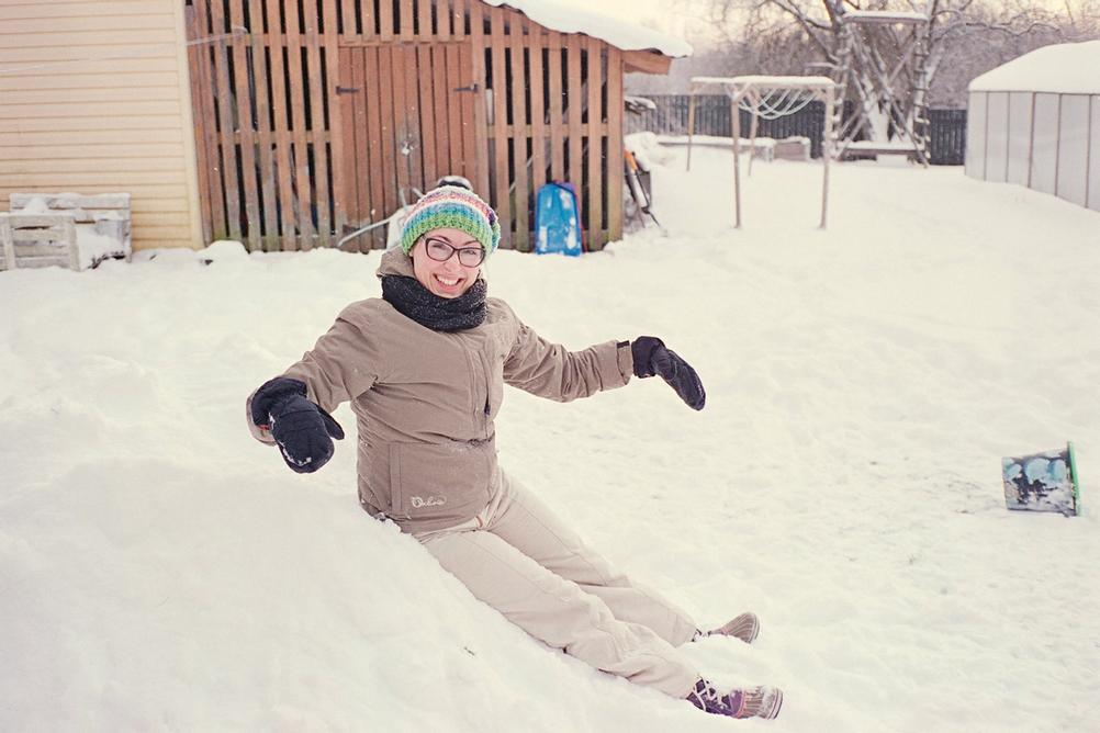 Smiling woman in snow.