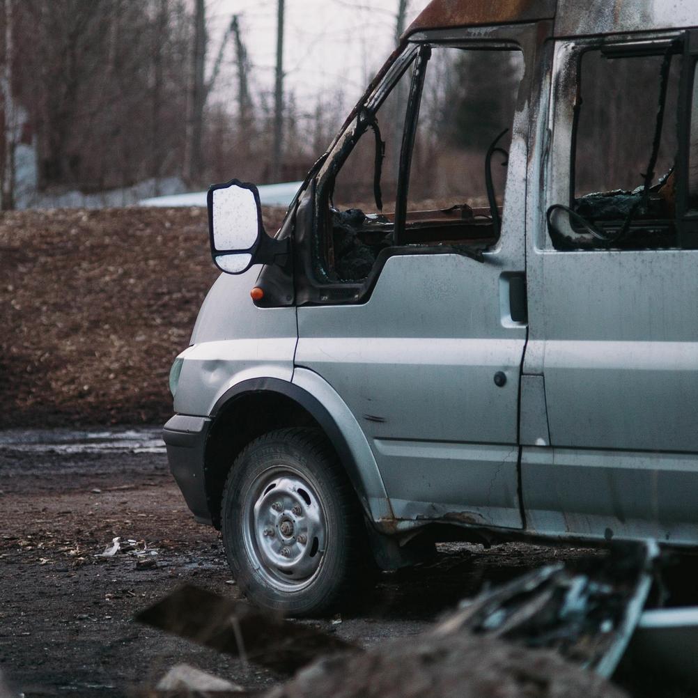 Photo of an broken down car.