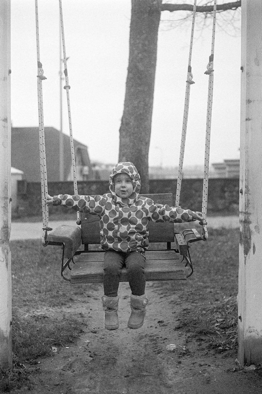 Photo of my daughter on a swing.